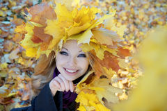 Girl in the autumn wreath Stock Photography