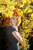 Girl in the autumn wreath Stock Photo
