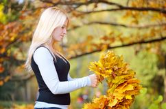Girl with autumn wreath Royalty Free Stock Photo
