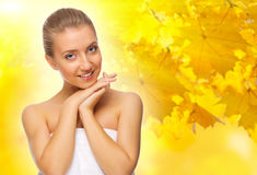 Girl on autumnal background Stock Image