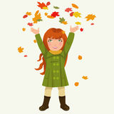 Girl and autumnal leaves Stock Image