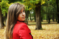Girl in the autumnal park Royalty Free Stock Images