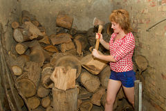 Girl with ax Royalty Free Stock Photography