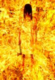 Girl with an axe in a fiery flame. Royalty Free Stock Images