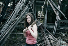 Girl with an axe Stock Image