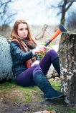 Girl with axe. Royalty Free Stock Photos