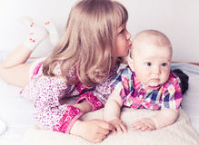 Girl with baby brother Royalty Free Stock Photography