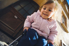Girl in Baby Carriage Stock Photography