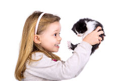 Girl with baby cat Stock Image