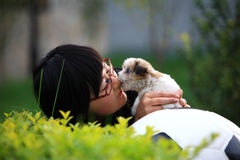 Girl and baby dog Stock Images