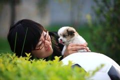 Girl and baby dog Royalty Free Stock Image