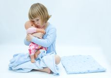 Girl and baby doll Royalty Free Stock Photo