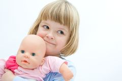 Girl and baby doll Royalty Free Stock Image