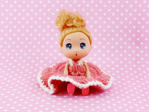 Girl baby doll pink dress  on pink polka background Stock Photography