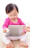 Girl baby happy play tablet PC Stock Images