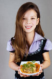 Girl (baby), holds plate with salad Royalty Free Stock Photo