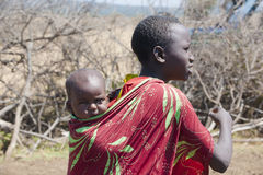Maasai girl with baby Royalty Free Stock Images