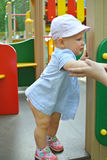 Girl baby on the playground Stock Images