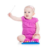 Girl baby playing musical toy Stock Photos