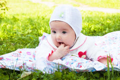 Girl baby a rattle played outdoors Stock Photo