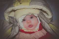 Girl baby in winter clothes looking at camera Royalty Free Stock Photos