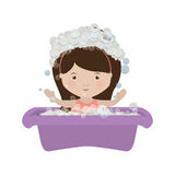 Girl in babys bathtub with soap bubble Stock Photo
