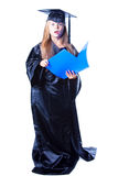 Girl with bachelor hat and graduation gown. Portrait of the beautiful girl with long fair hair wearing bachelor hat and graduation gown making speech and holding Stock Photos