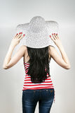 Girl is back with a hat Stock Photography