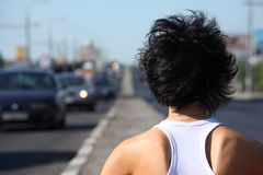 Girl from back, head and shoulders, on highway Stock Photos