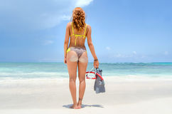 Girl back with snorkel Stock Images