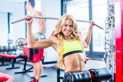 Girl at back sport training in fitness gym Stock Photo