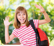 Girl back to school. Cheerful cute girl 10-11 year old posing at park. Happy pupil with backpack Stock Image