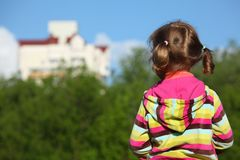 Girl from back, trees and houses Royalty Free Stock Image