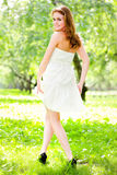 Girl back in white dress Royalty Free Stock Images