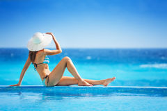 Girl from back with white hat in striped bikini Royalty Free Stock Photos
