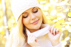 Girl on a background of autumn Stock Image