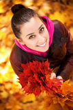 Girl on a background of  autumn leafs. top view Royalty Free Stock Image