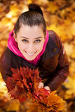 Girl on a background of  autumn leafs. top view Stock Photos