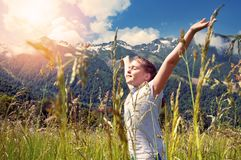 Girl in the background of beautiful mountains Royalty Free Stock Photo