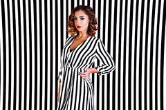 Girl at the background of black and white stripes Royalty Free Stock Images