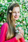 Girl on the background of a blossoming tree Royalty Free Stock Photography