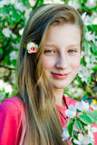 Girl on the background of a blossoming tree Royalty Free Stock Images