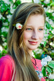 Girl on the background of a blossoming tree Royalty Free Stock Photos