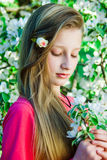Girl on the background of a blossoming tree Stock Photography