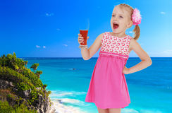 Girl on a background of blue sea Stock Image