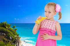 Girl on a background of blue sea Royalty Free Stock Photo