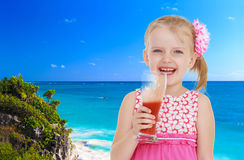 Girl on a background of blue sea Royalty Free Stock Photos