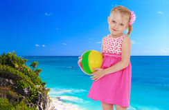 Girl on a background of blue sea Stock Photos