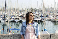 Girl on the background of boats in Barcelona Royalty Free Stock Image