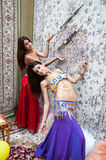 Girl on background of carpet Arab style Stock Images